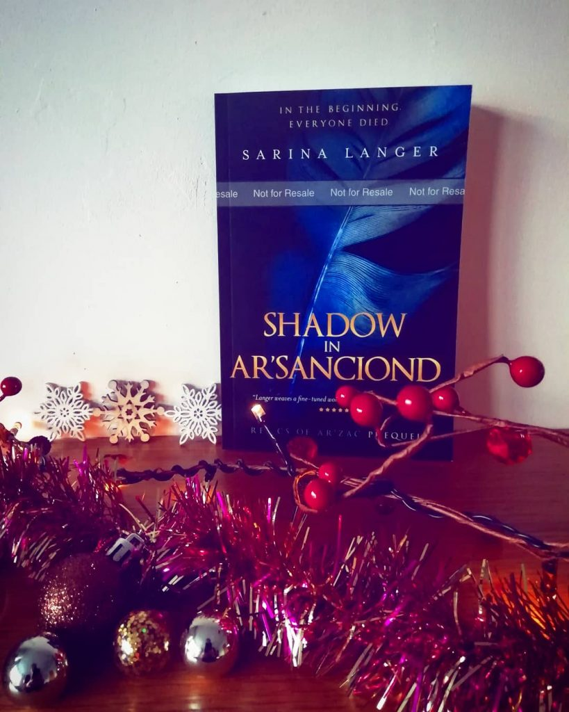 My dark epic fantasy prequel novella Shadow in Ar'Sanciond on my mantle.